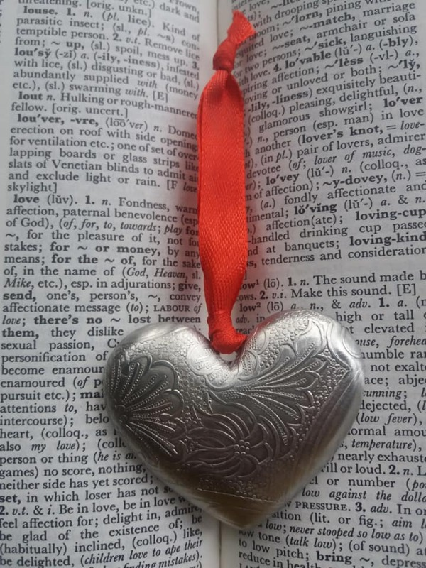 Heart Decoration. Embossed pewter with Victorian Scroll pattern. Fitted with a coloured silky ribbon. Dimensions :- Approx. 5.2cm width Approx. 4.5cm height