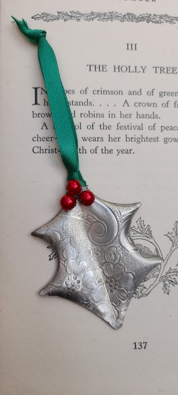 Holly Christmas Decoration with red Berries and Embossed Victorian Scroll Pattern.  fitted with coloured silky tassel. Dimensions :- Approx. 7cm height Approx. 5cm width
