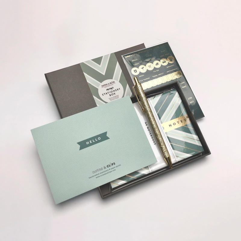 A stunning 4 piece box containing an assortment of Green and Metallic Gold stationery.