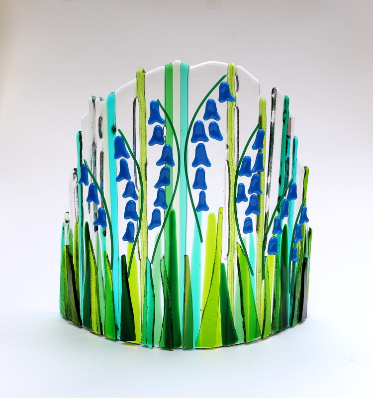 Fused glass blue bell curve made with layers of green and blue glass fully and partially fused. Size:22 X 23cm