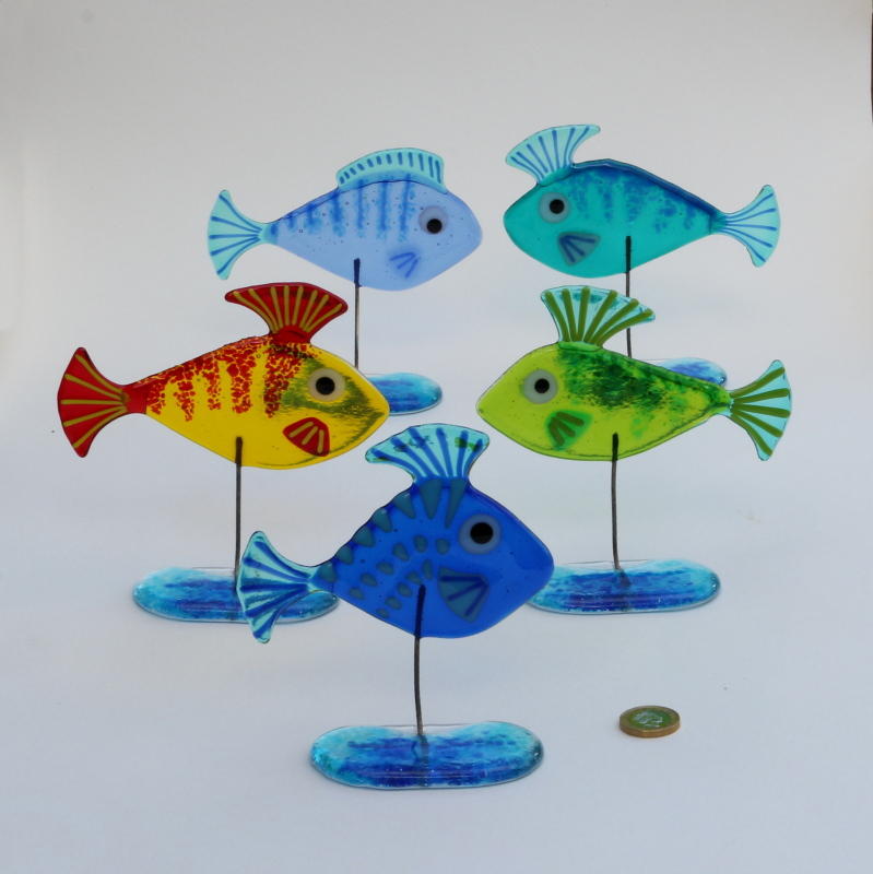 Fused glass free stand fish on blue glass bases. Variety of colours and designs available. Size: 15cm approx.