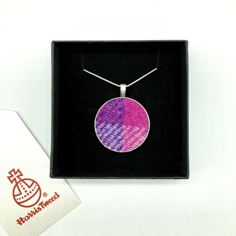 """Harris Tweed® fabric is mounted on a silver effect circular pendant. The pendant comes on a 925 silver plated 18"""" (45cm) snake chain. Two sizes to choose from a delicate 1""""  or a bolder 1.4"""" diameter."""