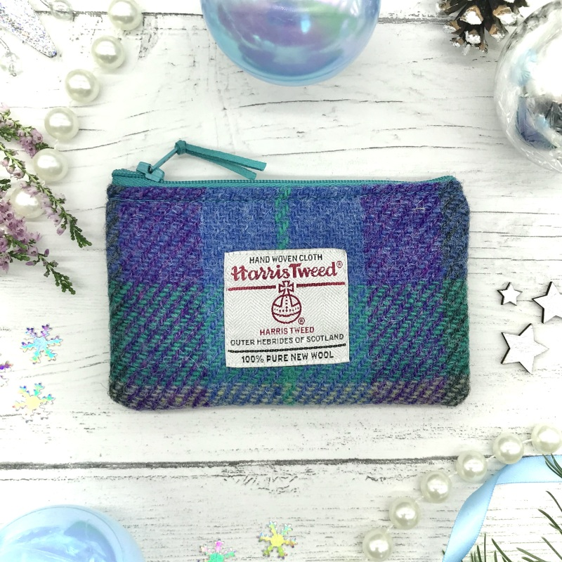 A perfect size for coins, cards and passes. It is closed with a zip for security and; is lined with a complementary colour where there is also a Tweedie Bag label. The purse has been made with vilene to stiffen it, maintaining structure.