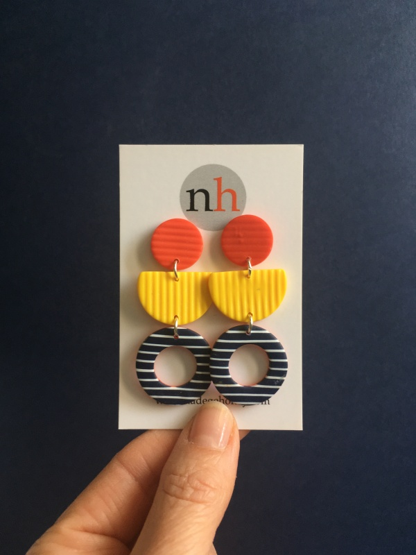 Elegant, chic and so French. A bright pair of earrings in primary colours with stripes. Reminiscent of the long summer days.