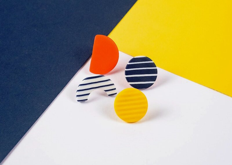 Elegant, chic and so French. A selection of 4 mix and match stud earrings in navy and white stripes, yellow and red. Comes in its own box. Reminiscent of the long summer days.