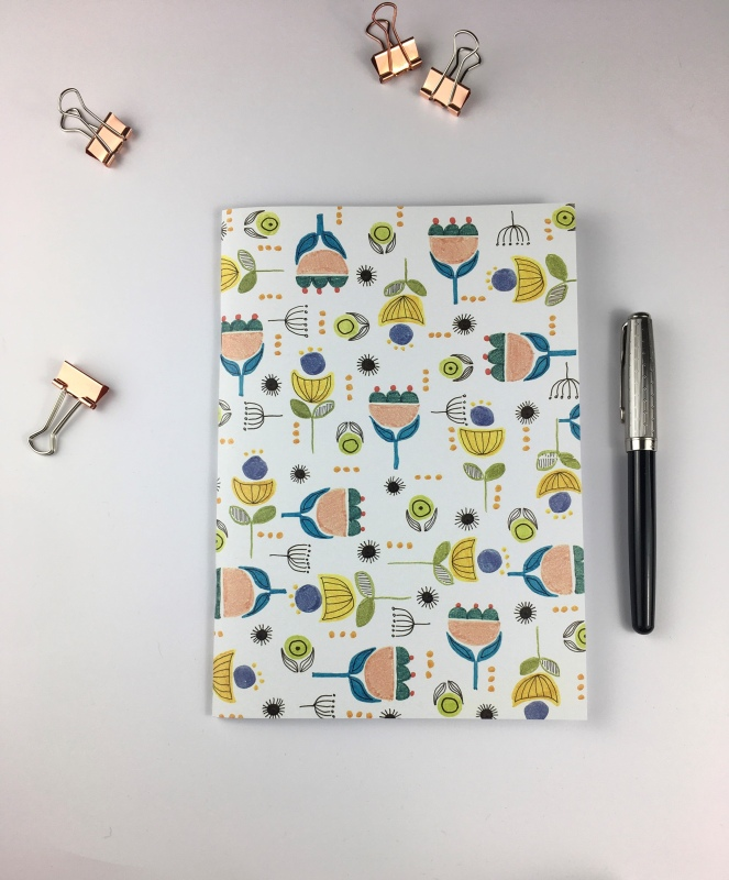 A selection of colourful blank pages notebooks printed from my original drawings.