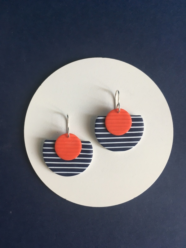 Elegant, chic and so French. A striking pair of stripey earrings in navy and red. Also available in white and yellow. Reminiscent of the long summer days.