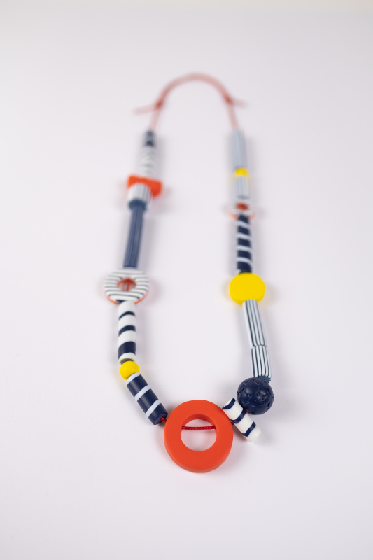 Elegant, chic and so French. A bright long necklace in primary colours, reminiscent of the long summer days.
