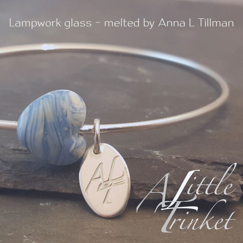 Cora Heart Bangle from the Noviomagus Collection - A handmade glass heart on an oval sterling silver bangle with hallmarked tag. Available in Small, Medium and Large sizes RRP £35