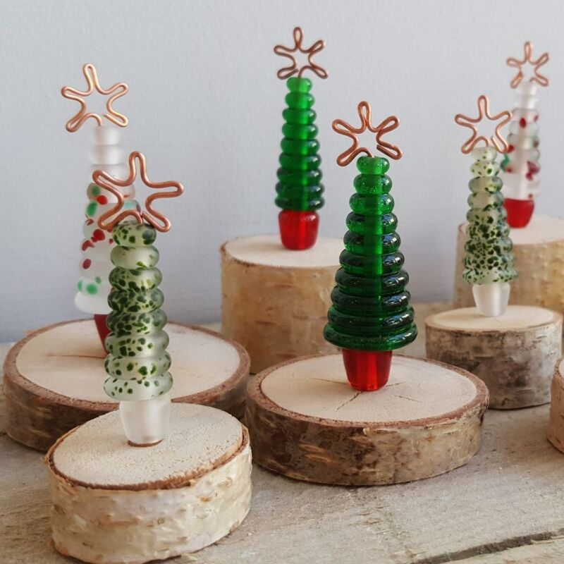 Christmas tree bundles are a quick way to get a mini forest on your shelves - Choose from Standing, Hanging or a mix of both types of tree. Total RRP £432, £12 each