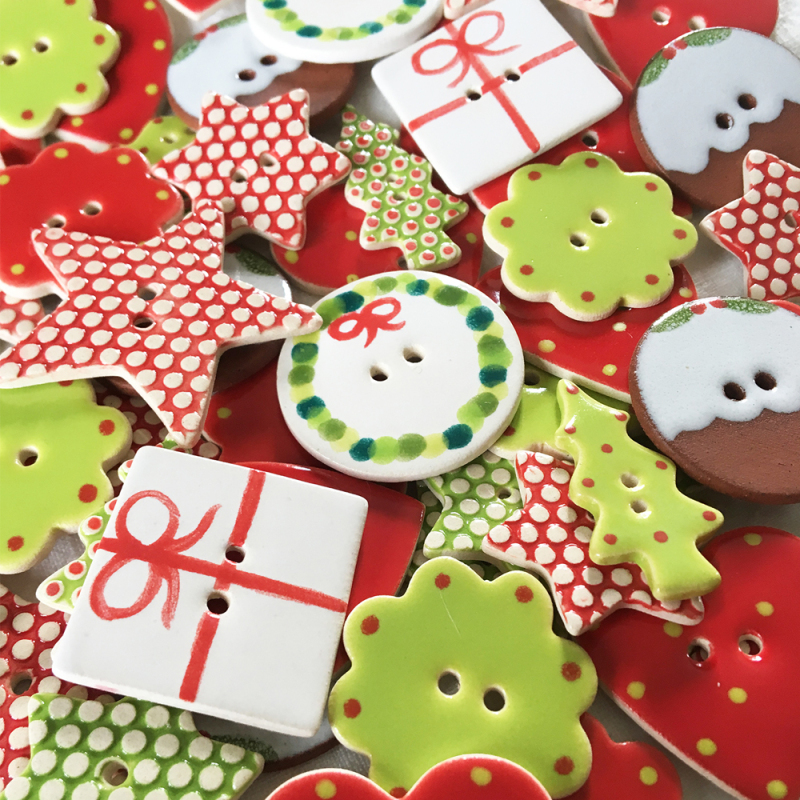Perfect gift items for the festive season. Choose from Christmas puddings, stars, wreaths and many more hand painted buttons. All handmade in Cornwall, UK.