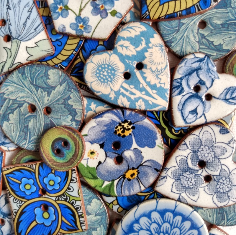 A selection of blue buttons from our Heritage and Floral ranges. Irresistible to customers when displayed on a plate or in a bowl near the till
