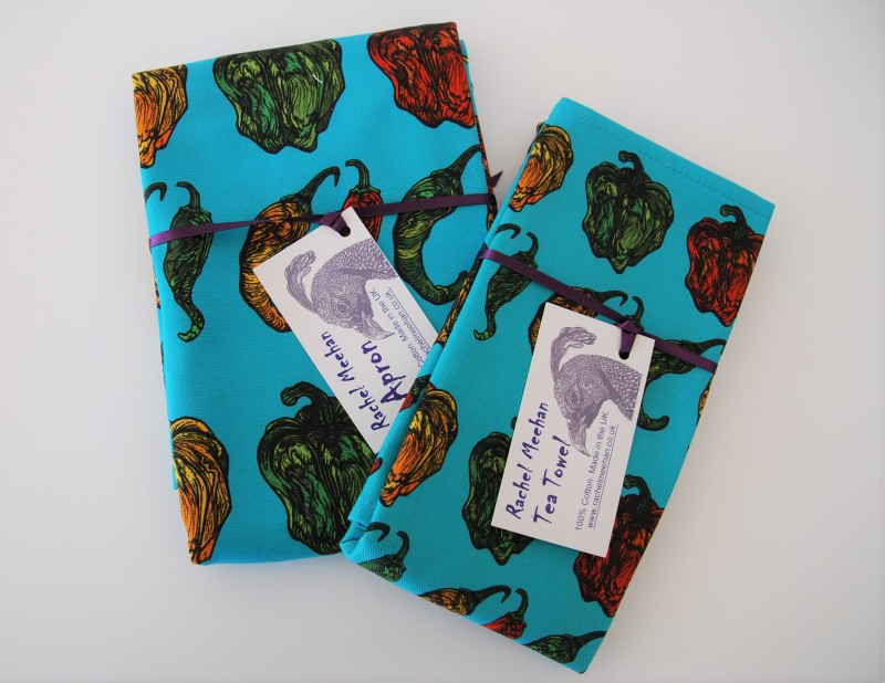 100% half panama cotton, 309 gsm with care label , adjustable neck strap on apron and hanging hook on tea towel