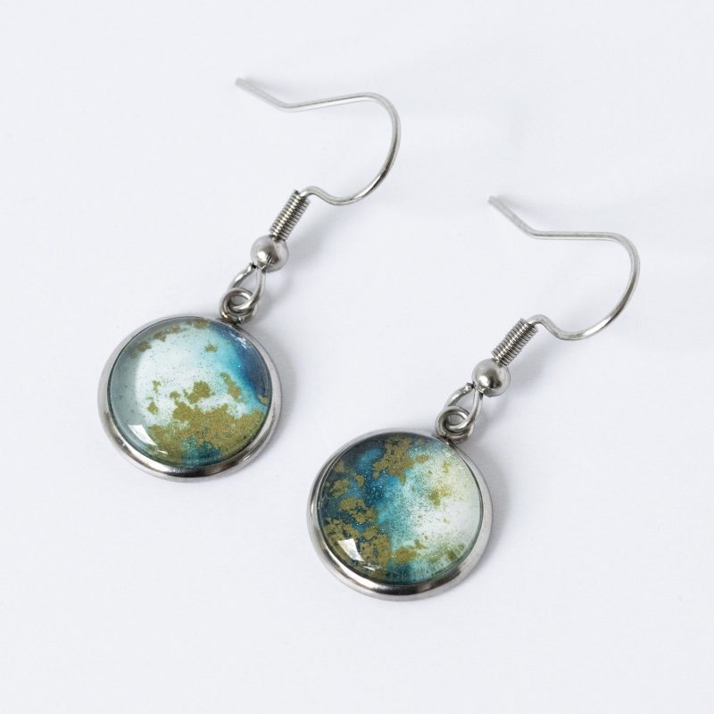 Hypoallergenic surgical steel, fish hook drop earrings containing unique pieces of alcohol ink art, sealed with a glass cabochon