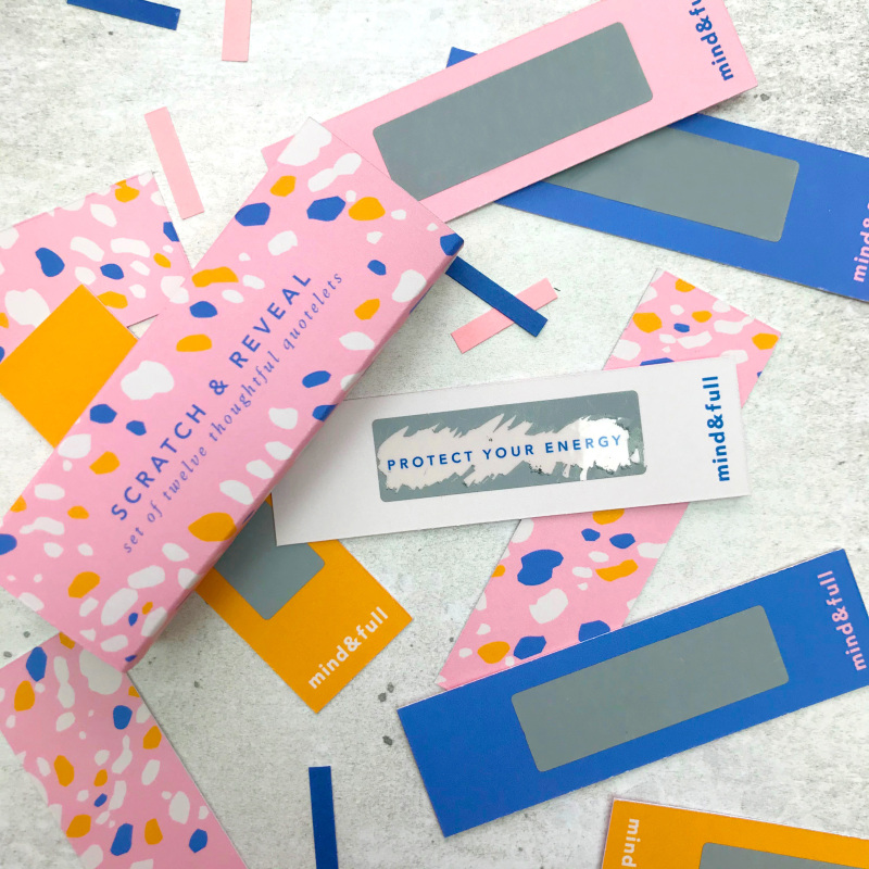 A set of 12 motivational Scratch and Reveal quotelets. Scratch away the foiled panel to reveal an inspirational quote to start your day! Each of these vibrant quotelets have a different sentiment and come in a neat box with contrasting pattern.
