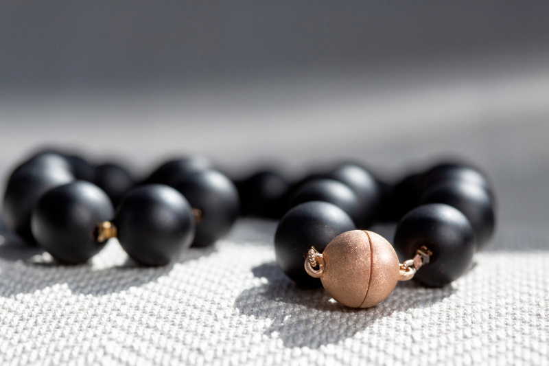 Unique matt finish large onyx beads given a subtle sparkle by interspersed copper coated hematite and a magnificent rose gold plated magnetic clasp for perfect in any season. Matt or frost finish coloured stones are available in many sizes and types.