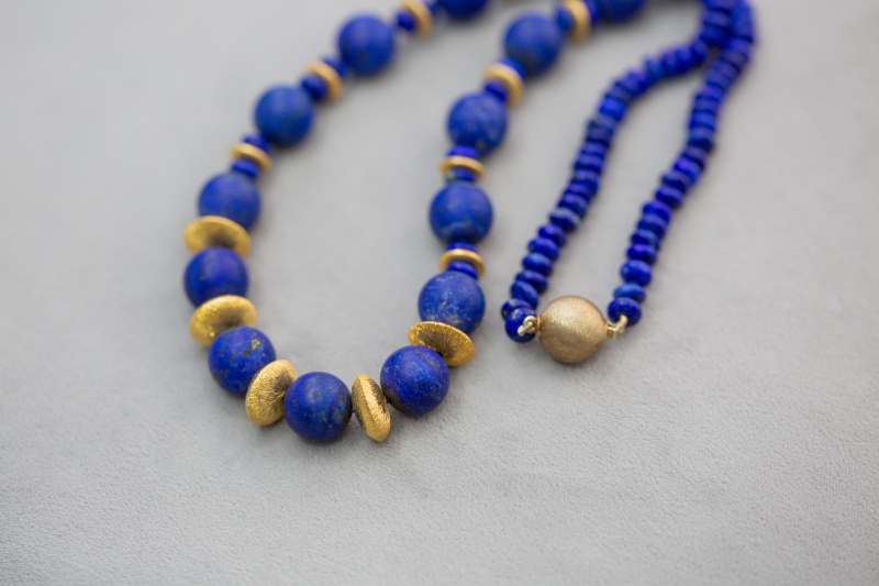 This beautiful royal blue and silver gilt necklace is hand knotted.  Matt finish large Lapis lazuli stone beads, beautifully combine with silver gilt discs and polished lapis lazuli to make this statement piece.