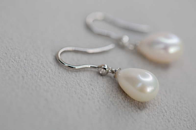 Gift classic elegance to a loved one or to yourself!  These stunning teardrop cultured pearls are set onto white gold hooks inset with a delicate diamond.