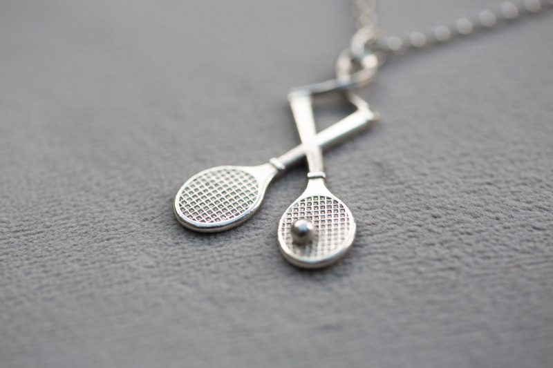 Cast from a vulcanised mould created from an original design, these cute rackets can be cast in silver or gold and hand finished into pendants, pins or earrings.