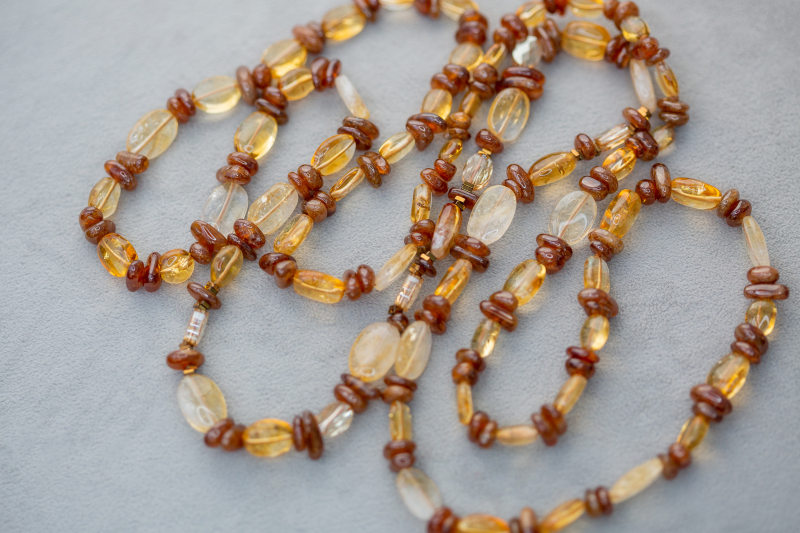 With no clasp needed, this long necklace can be worn as one or a double strand.  Hidden amongst the freeform hessonite garnets and citrine are 6 very special Swarovski crystal rondelles to give extra light catching sparkle.