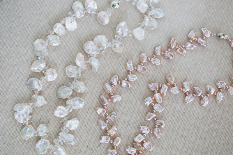 These two unique necklaces are perfect for summer parties or simply to feel special in your own home.  The lustre of the white pearls is further enhanced by quartz crystal pebbles and the pale herringbone pearls  with delicate toning pink seed pearls