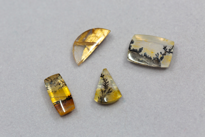 These real crystal quartz gems are created entirely by Mother Nature, then cut and polished by hand to bring out the landscape patterns and golden hues.  They are available to design into unique pendants in complementary style and precious metal.