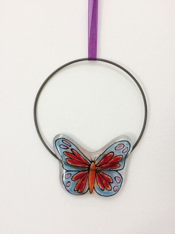 This fused glass Butterfly Circle Hanging is hand painted and I have used coloured glass powders.  The wire circle is approx 10cm diam.  It comes in tissue/bubble wrap and in a box.