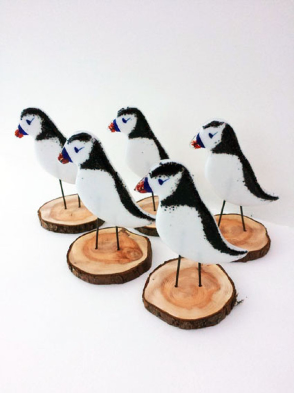 Fused glass standing Puffin on a wood stand.  Made with cut glass, frit and hand painted. Approx. 14 x 10cm.