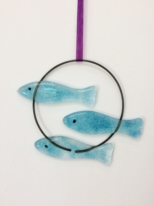 This fused glass 3 Fish Circle Hanging is hand painted and I have used coloured glass powders.  The wire circle is approx 10cm diam.  It comes in tissue/bubble wrap and in a box.