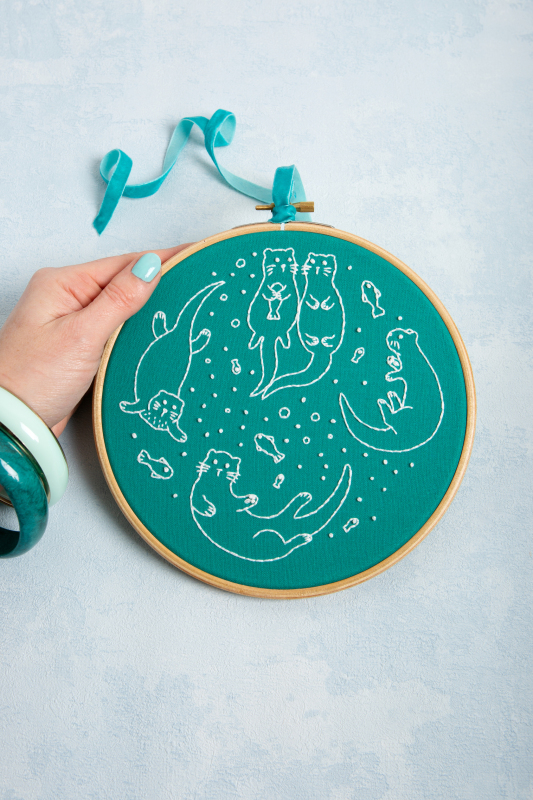 Awesome Otters. A popular embroidery kit from our Brights range with a fun design stitched in white on a bright background. Look out for Dandy Dogs on a gorgeous blue, Bouncing Bunnies on a sunny yellow & Red Red Robins on a deep red, plus many more.