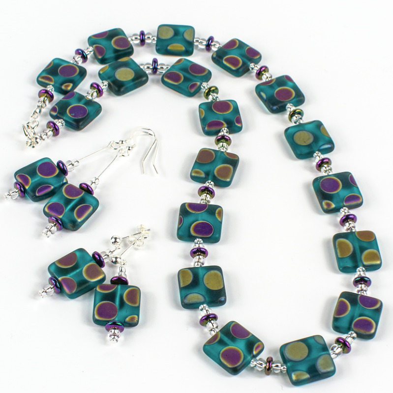 A statement necklace in frosted teal Czech glass with multi coloured spots has a presence of it's own. Bold and gorgeous bringing something extra to your outfit. Length approx 51cm. With sterling silver findings.  Items sold separately.