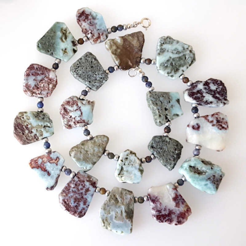 Luscious larimar slabs, polished and rough with wonderful colours.  Separated by Jasper beads and silver tone glass rocailles.  Sterling silver fastening. Length 50cm.
