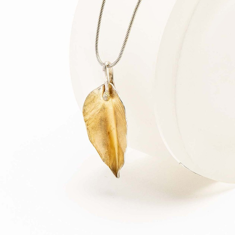 Hand-forged leaf. The front of the leaf is gold plated, giving a flash of colour. Sterling silver.