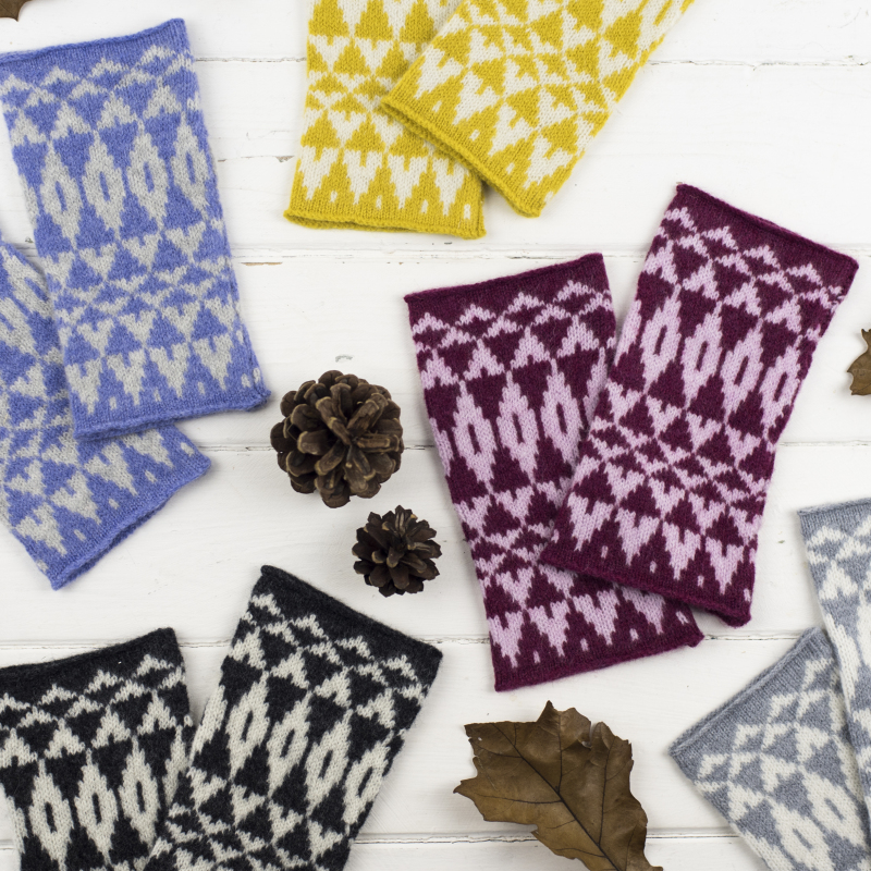 Knitted fingerless wristwarmers made from 100% lambswool and knitted in a geometric mirror pattern. The length of the wristwarmers keeps your hands and wrists cosy and warm, whilst leaving your fingers free to do tasks. Knitted in our Surrey studio.