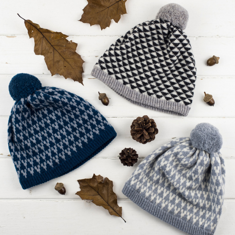 Knitted pom pom hats made in Scotland from lambswool.