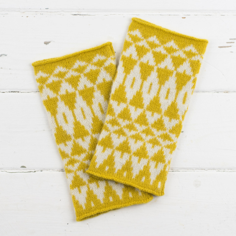 Knitted fingerless wristwarmers made from 100% lambswool and knitted in a geometric pattern.