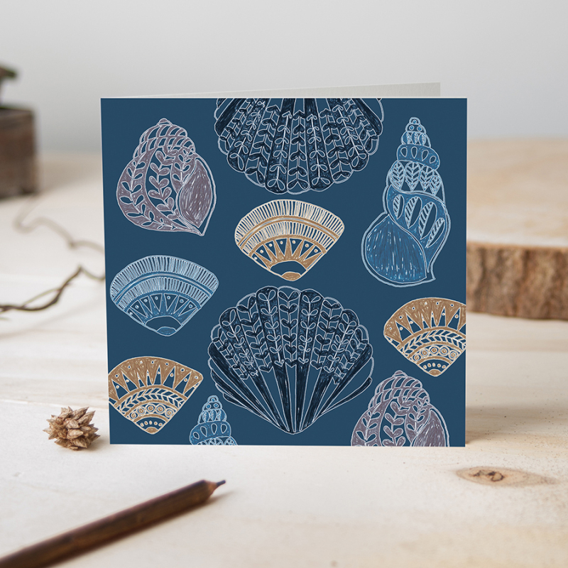 craffito combines the lure of the sea and its organic shapes with the pared back palette of ecru, blues and white.  Fish, shells, crabs and seagulls play happily across the card collection with a whimsical take that is purely Perkins & Morley.