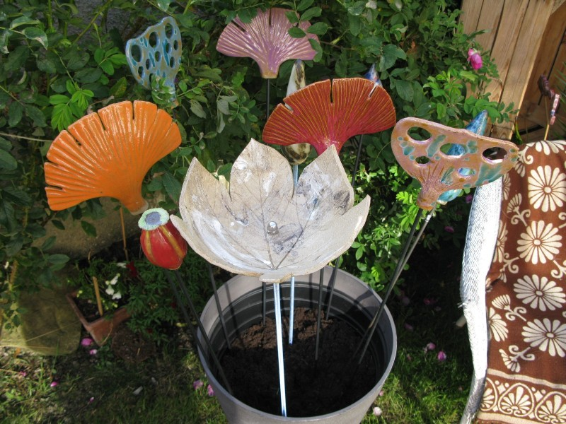 Our premium quality handcrafted ceramic garden artworks look good out of doors, 'planted' in borders, in containers on patios or balconies or as interior decoration features. Use as singles or in clusters to add colour and interest all year
