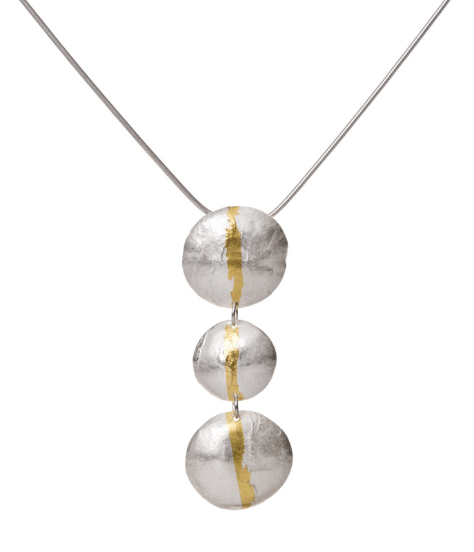 A unique textured fine silver drop pendant, featuring a 24-carat gold stripe. This has been applied using the Koreantechnique of Keum boo, which fuses the gold onto the silver using heat and pressure.