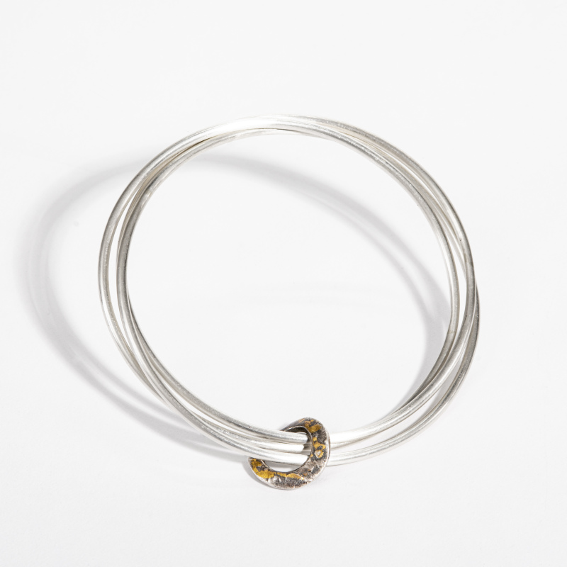 The hoop is curved and holds the three bangles together. The hoop has been hallmarked in Sheffield. This design is available in small, medium and large.