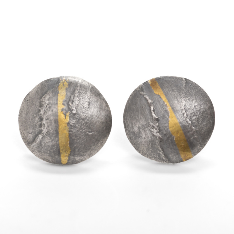 These small stud earrings have a thin gold stripe running down the centre of them and have been oxidised to enhance this.