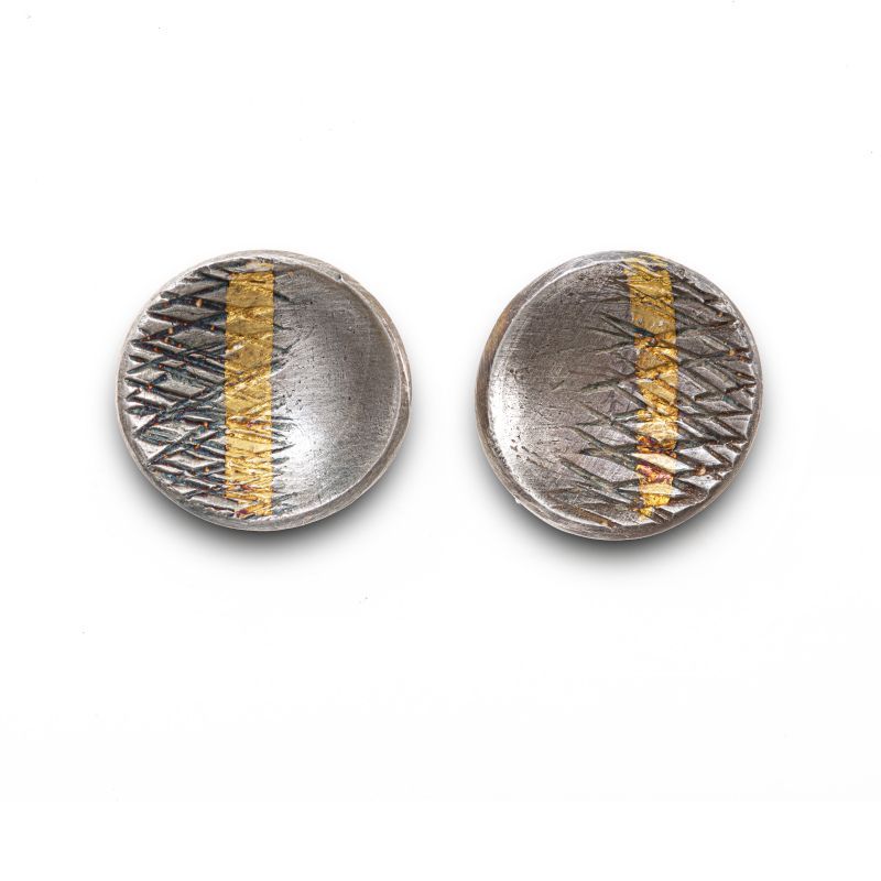 Small cupped textured stud earrings handcrafted in silver and oxidised to enhance the 24-carat gold stripe.