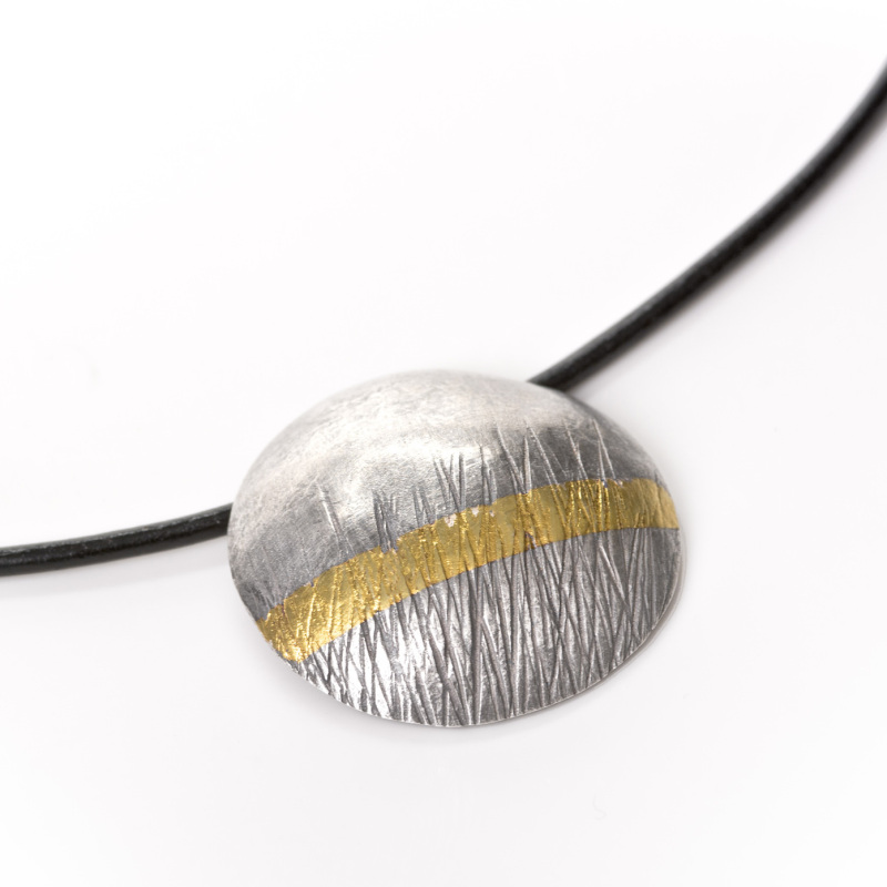 This choker has been oxidized, to enhance the texture and highlight the gold stripe. The stripe has been fused onto the silver, using a technique called Keum Boo, which is a Korean technique which enables you to fuse the 24-carat gold onto silver.